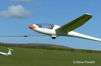 A glider being launched by winch
